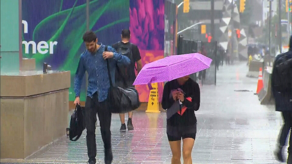Torontonians race through the city during torrential downpours on August 21, 2018.
