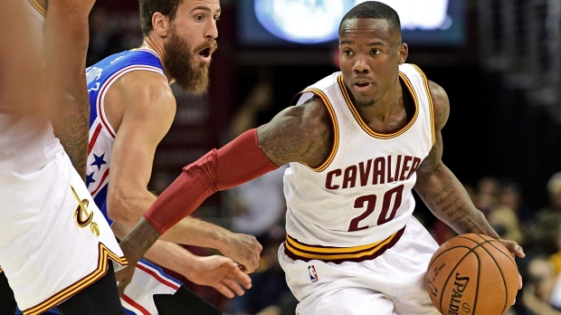 n this Saturday, Oct. 8, 2016 file photo, Cleveland Cavaliers guard Kay Felder (20) drives around Philadelphia 76ers guard Sergio Rodriguez (14) in the first half of an NBA preseason basketball game in Cleveland. (AP Photo/David Dermer, File)