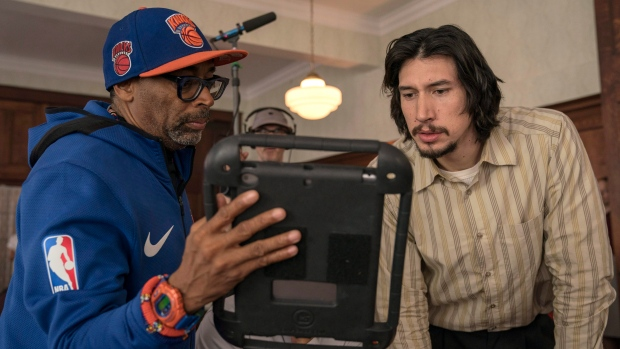 """This image released by Focus Features shows director Spike Lee, left, with actor Adam Driver on the set of Lee's film """"BlacKkKlansman."""" (David Lee/Focus Features via AP)"""