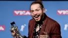 """Post Malone poses with the award for song of the year for """"Rockstar"""" in the press room at the MTV Video Music Awards at Radio City Music Hall on Monday, Aug. 20, 2018, in New York. (Photo by Evan Agostini/Invision/AP)"""
