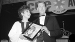 """FILE - In this Jan. 4, 1967 file photo, Barbara Harris, star of """"The Apple Tree"""" receives Cue Magazine's """"Entertainer of the Year"""" award from last year's winner, director Mike Nichols in New York. (AP Photo/Marty Lederhandler, File)"""