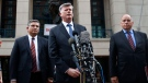 Kevin Downing, center, with members of the defense team for Paul Manafort, Richard Westling, left, and Thomas Zehnle, right, speaks to the media after federal court after Manafort, the longtime political operative who for months led Donald Trump's winning presidential campaign, was found guilty of eight financial crimes in the first trial victory of the special counsel investigation into the president's associates in Alexandria, Va., Tuesday, Aug. 21, 2018. (AP / Jacquelyn Martin)