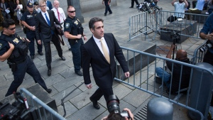 Michael Cohen, former lawyer to U.S. President Donald Trump, departs following his appearance in Federal Court on Tuesday, Aug. 21, 2018, in New York. (AP Photo/Kevin Hagen)