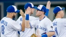 Toronto Blue Jays left fielder Billy McKinney, right, celebrates with teammate Kendrys Morales (8) after defeating the Baltimore Orioles during ninth inning AL baseball action in Toronto on Tuesday, August 21, 2018. THE CANADIAN PRESS/Nathan Denette