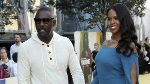Director Idris Elba, left, and partner Sabrina Dhowre pose for photographers on arrival at the premiere of the film 'Yardie', in London on Tuesday, Aug. 21, 2018. (Grant Pollard/Invision/AP)