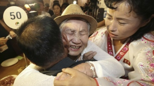 South Korean Lee Keum-seom, 92, centre, hugs her North Korean son Ri Sang Chol, 71, left, with Kim Ok Hui, daughter-in-law of Ri Sang Chol during the Separated Family Reunion Meeting at the Diamond Mountain resort in North Korea on Monday, Aug. 20, 2018. (Lee Ji-eun/Yonhap)