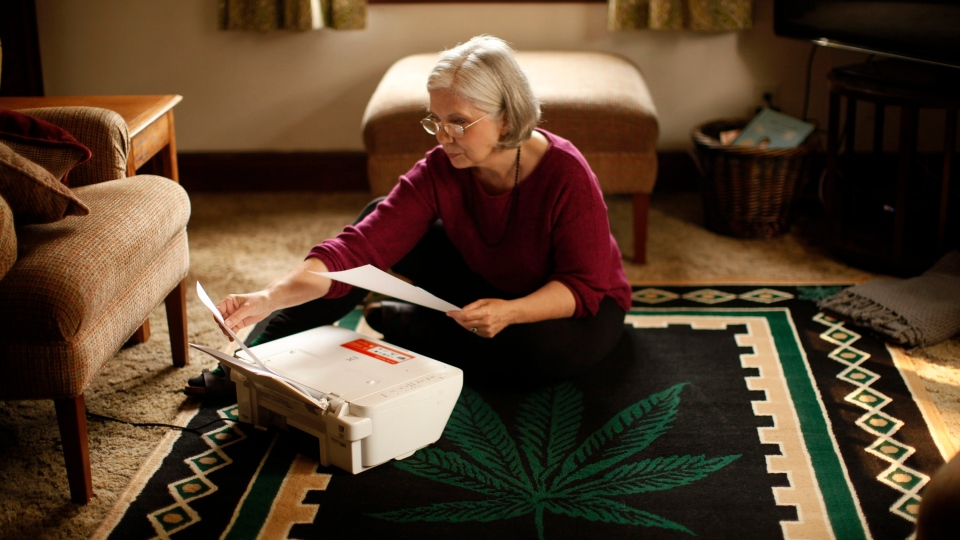 Cannabis user and grandmother Carol Francey, also known as Granny Grass is photographed printing a letter to the editor from her home in Victoria, B.C., on Monday, August 20, 2018. (THE CANADIAN PRESS/Chad Hipolito)