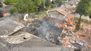 The aftermath of the explosion at Sprucedale Crescent. The house was completely destroyed, and the adjacent homes also caught fire. (WRPS / Twitter)