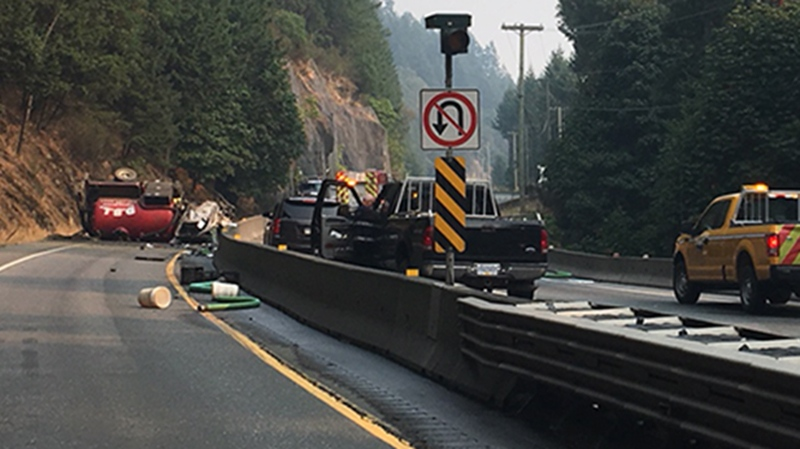 RCMP say one driver is dead and another injured after a sewage truck rolled over on the Malahat Highway near Goldstream Provincial Park. Aug. 22, 2018. (CTV Vancouver Island)