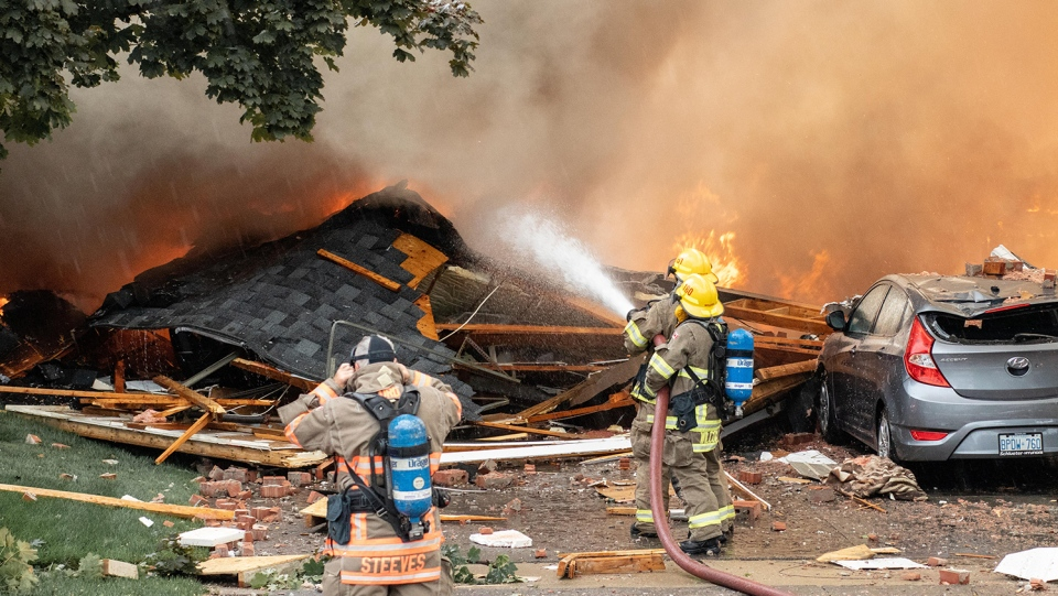 Crews work at the scene of a house explosion in Kitchener, Ont. Wednesday, Aug. 22, 2018. (Credit: Chris Imperatore / MyNews)