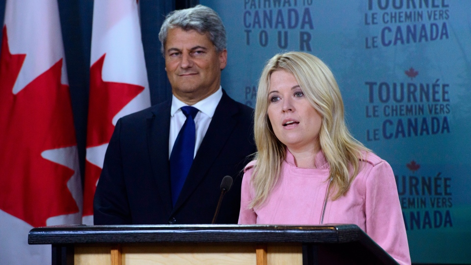 Michelle Rempel, Conservative immigration, refugees and citizenship critic, and Gerard Deltell, Conservative Treasury Board critic, hold a press conference at the National Press Theatre in Ottawa on Wednesday, Aug. 22, 2018. (Sean Kilpatrick / THE CANADIAN PRESS)