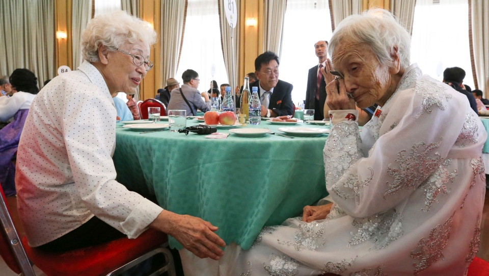 South Korean Cho Hye-do, 86, left, talks with her North Korean sister Cho Sun Do, 89, in a bid farewell after the Separated Family Reunion Meeting at the Diamond Mountain resort in North Korea, Wednesday, Aug. 22, 2018. (Korea Pool Photo via AP)