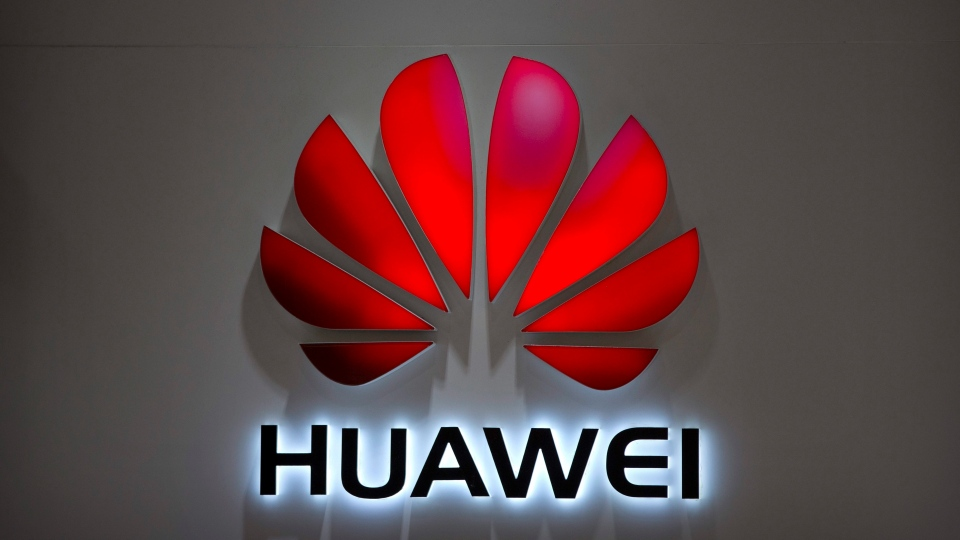 In this Wednesday, July 4, 2018, photo, the Huawei logo is seen at a Huawei store at a shopping mall in Beijing. (AP Photo/Mark Schiefelbein, File)