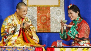 Sakyong Mipham Rinpoche, left, and his bride Princess Tseyang Palmo smile during their Tibetan Buddhist royal wedding ceremony in Halifax on Saturday, June 10, 2006. THE CANADIAN PRESS/Andrew Vaughan