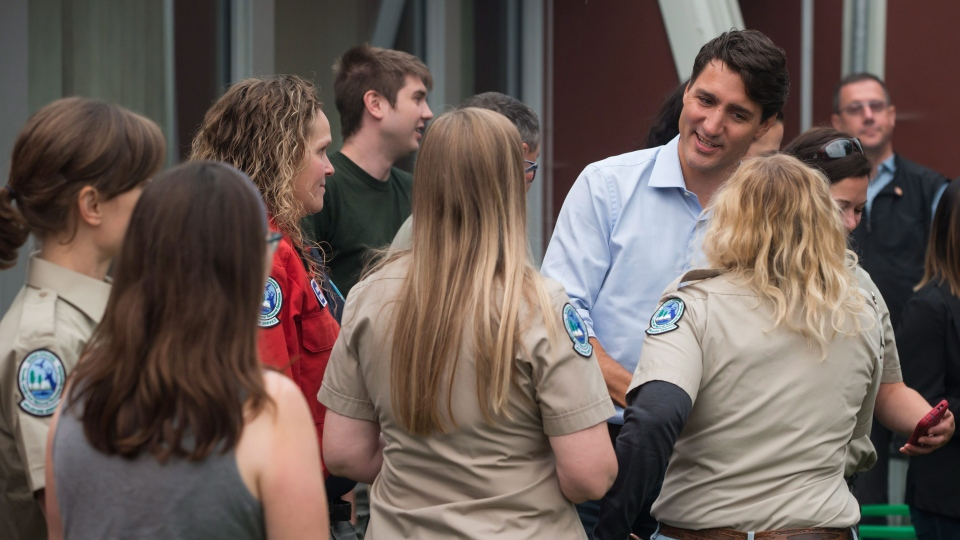Prime Minister Justin Trudeau, back right, meets British Columbia Wildfire Service staff during a visit to the Prince George Fire Centre, in Prince George, B.C., on Thursday August 23, 2018. THE CANADIAN PRESS/Darryl Dyck