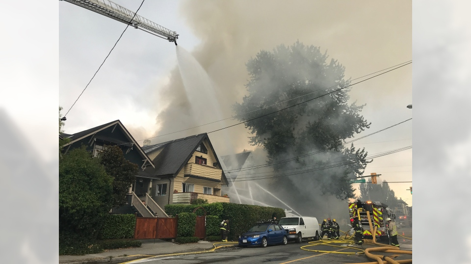 Firefighters were called to a blaze at a home on MacDonald Street and West 3rd Avenue on Thursday, Aug. 23, 2018. (Shelley Moore / CTV Vancouver)