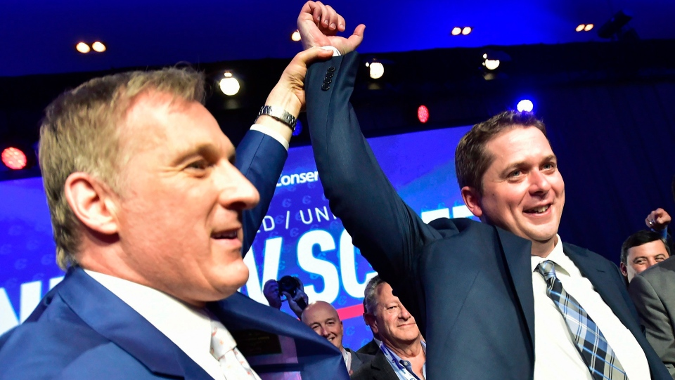 In this file photo, Andrew Scheer, right, is congratulated by Maxime Bernier after being elected the new leader of the federal Conservative party at the federal Conservative leadership convention in Toronto on Saturday, May 27, 2017. THE CANADIAN PRESS/Frank Gunn