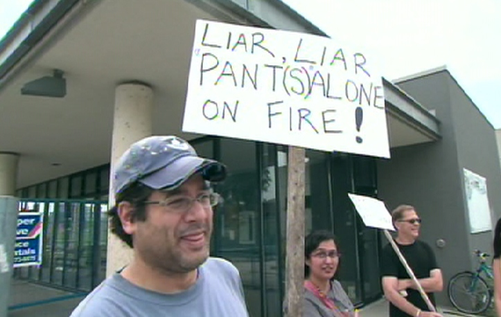 Some residents protest the location of one of the new 19 trash drop-off stations in Toronto, Thursday, June 25, 2009.