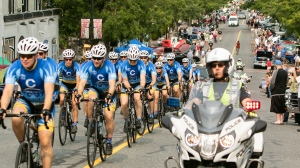 Civilian Alli Roberts, third from the left, participates in the Canadian Cancer Society Cops for Cancer Tour de Rock team on its 2018 Mock Tour. (Arnold Lim/Black Press)