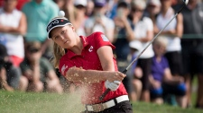 Brooke Henderson, of Smiths Falls, Ont., takes a shot out of the sand trap on the 17th green during the CP Women's Open in Regina, Friday, August, 24, 2018. (THE CANADIAN PRESS Jonathan Hayward)