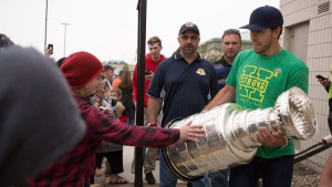 Washington Capitals left wing Chandler Stephenson carries the Stanley Cup outside Elgar Petersen Arena during the Humboldt Hockey Day event in Humboldt, Sask., Friday, August 24, 2018. THE CANADIAN PRESS/Kayle Neis