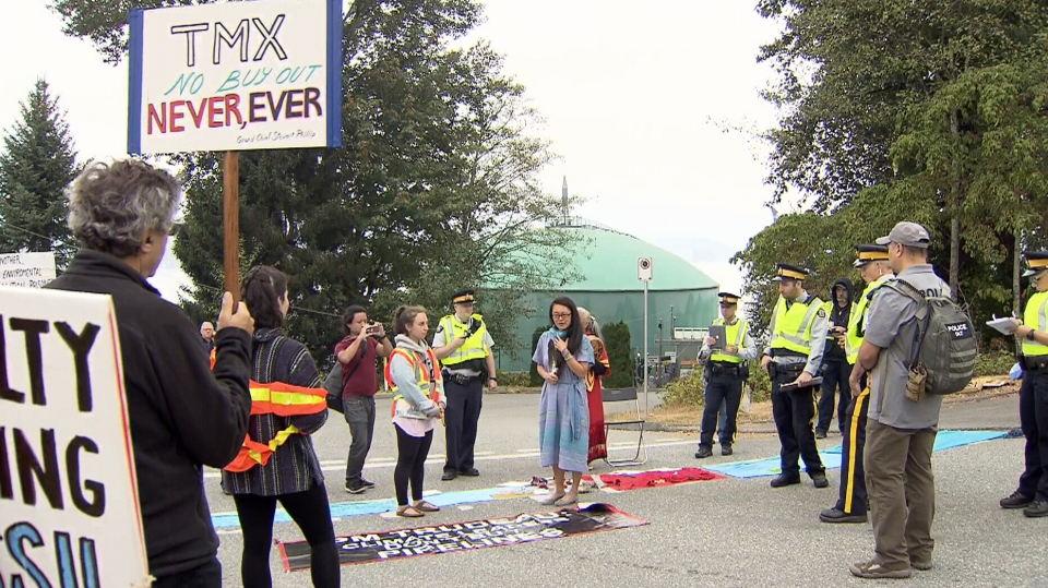 Ring Wong, centre, is seen at a pipeline protest on Burnaby Mountain on Aug. 24, 2018.