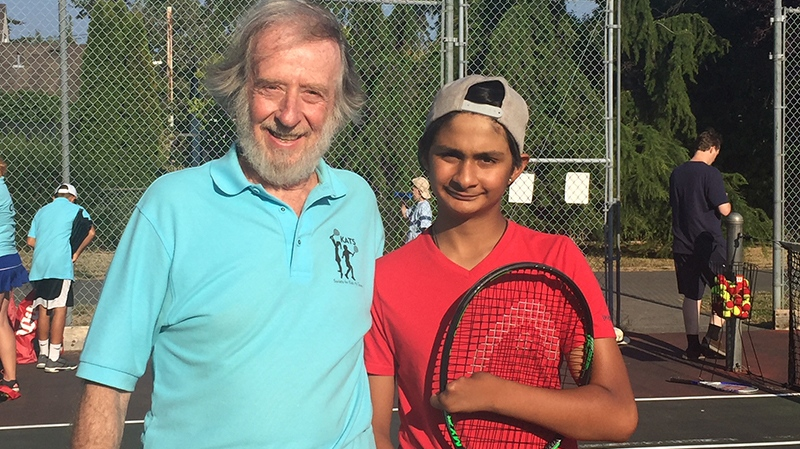 Thirteen-year-old Victoria tennis player Ethan Barwise, seen with KATS program creator Sy Syilverberg, has become a role model for other kids, and has even started coaching younger players. Aug. 16, 2018. (CTV Vancouver Island)