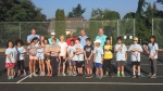 Members of the Society for Kids at Tennis, or KATS, are seen at the Oaklands Tennis Courts in Victoria. KATS provides free tennis lessons, and even racquets if needed, to disadvantaged children. Aug. 16, 2018. (CTV Vancouver Island)