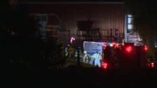 Emergency crews at a farm at night