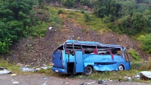 In this handout photo provided by the Bulgarian Interior Ministry, a view of a bus that crashed and overturned, near the town of Svoge, Saturday, Aug. 25, 2018. (Bulgarian Interior Ministry via AP)