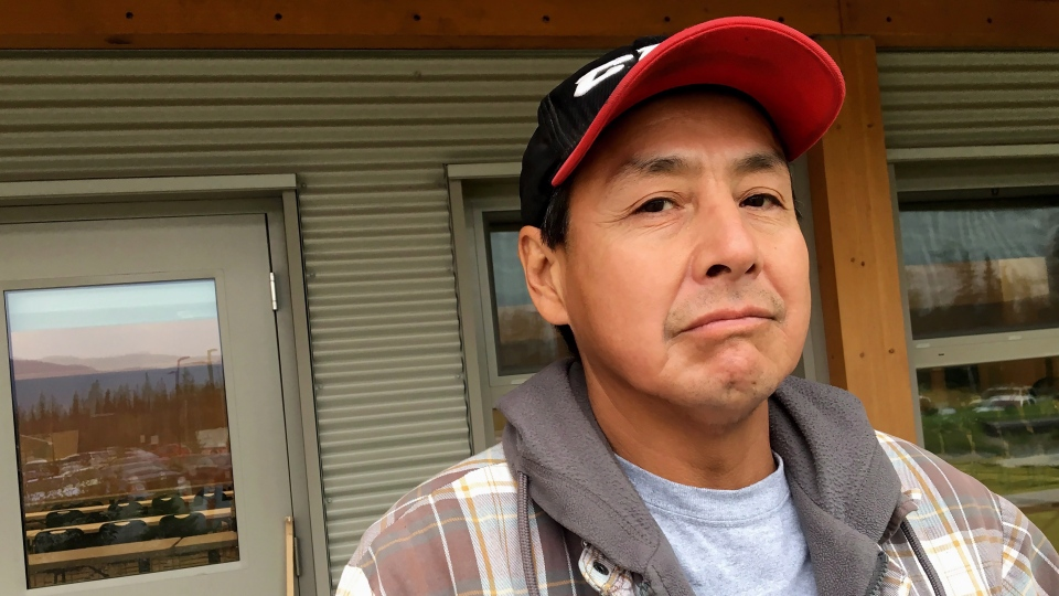 Lester George stands in front of the Nadleh Whut'en First Nation band office in Fort Fraser, B.C., on Thursday, Aug. 23, 2018. George is defying an evacuation order to defend his property. THE CANADIAN PRESS/Laura Kane