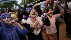 Rohingya women cry as they shout slogans during a protest rally to commemorate the first anniversary of Myanmar army's crackdown which lead to a mass exodus of Rohingya Muslims to Bangladesh, at Kutupalong refugee camp in Bangladesh on August 25, 2018. THE CANADIAN PRESS/AP, Altaf Qadri
