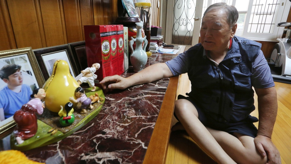 In this Aug. 23, 2018, photo, Ham Sung-chan, 93, watches gifts he received from his North Koran brother Ham Dong Chan during an interview at his house in Dongducheon, South Korea (AP Photo/Ahn Young-joon)