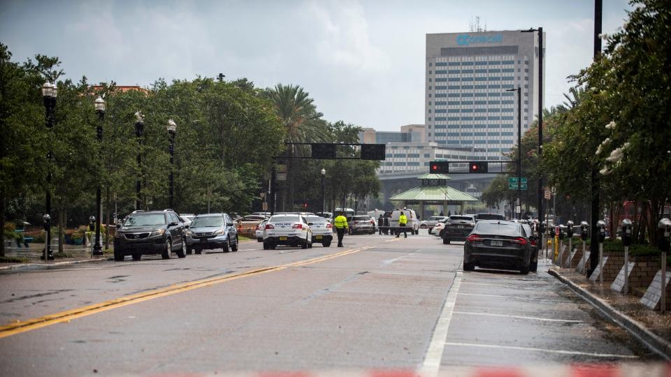 Police barricade a street near the Jacksonville Landing in Jacksonville, Fla., Sunday, Aug. 26, 2018. (AP Photo/Laura Heald)