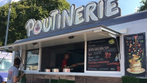 """Owners Masha Klimova and Alexey Kolesov's """"Poutinerie"""" food truck is being prepared for the day at the Faces & Laces Festival in Gorky Park, Moscow, Russia, Saturday August 18, 2018. (THE CANADIAN PRESS/Melanie Marquis)"""