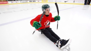 Ryan Straschnitzki takes to the ice to practice his sledge hockey skills in Calgary on Tuesday, August 7, 2018. Straschnitzki was injured in the Humboldt Broncos bus crash. (THE CANADIAN PRESS / Todd Korol)