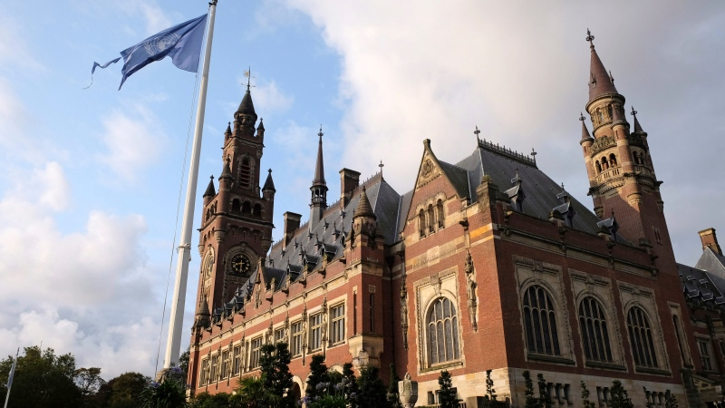 A United Nations flag flutters in the wind next to the International Court of Justice in the Hague, the Netherlands, Monday Aug. 27, 2018. (AP Photo/Mike Corder)