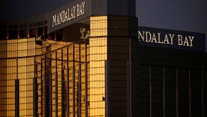 In this Oct. 3, 2017, file photo, windows of a room are broken after a high-stakes gambler opened fire on a concert below in a mass shooting from the Mandalay Bay resort and casino in Las Vegas.(AP Photo/John Locher, File)