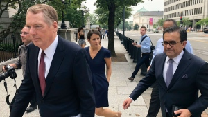 "United States Trade Representative Robert Lighthizer, left, and Mexican Secretary of Economy Idelfonso Guajardo, right, walk to the White House on Monday August 27, 2018. President Donald Trump says the prospects are ""looking good"" for an agreement with Mexico that could set the stage for an overhaul of the North American Free Trade Agreement. (AP Photo/Luis Alonso Lugo)"