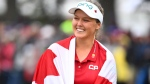 Canada's Brooke Henderson is wrapped in a Canadian flag as she celebrates her win at the CP Women's Open in Regina on Sunday, August 26, 2018. THE CANADIAN PRESS Jonathan Hayward