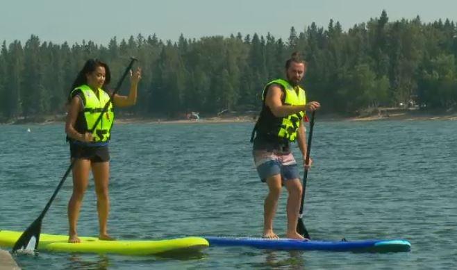 Paddle boarding in Waskesiu