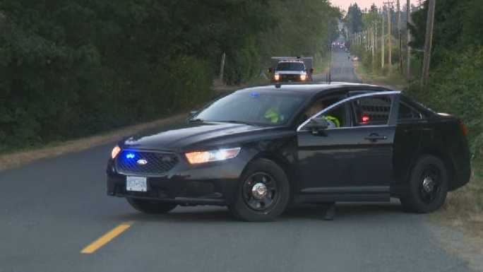 An unmarked Central Saanich Police vehicle cordons off Central Saanich Road after a fatal collision. Mon., Aug. 27, 2018. (CTV Vancouver Island)