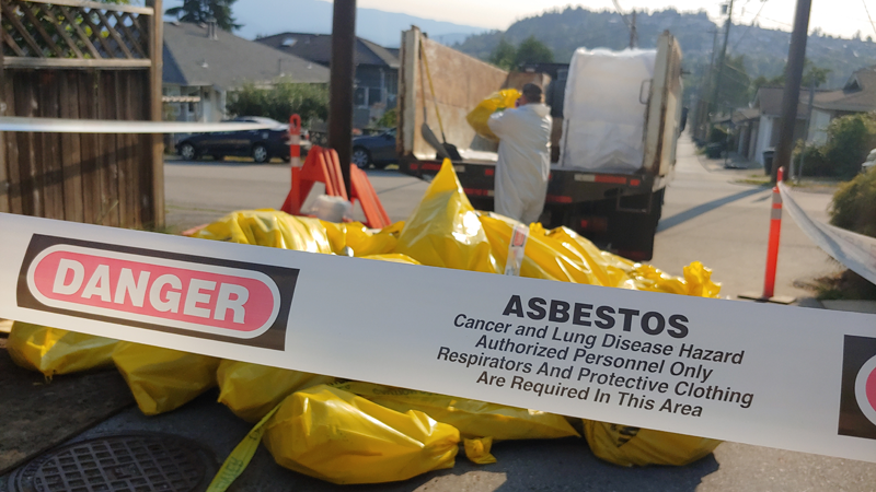 The city is trying to determine who left dozens of asbestos bags in a residential neighbourhood over the weekend.