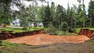 A sinkhole is shown in Oxford, N.S. on Aug.27, 2018 in a handout photo. A Nova Scotia town is urging the public to take caution as officials scramble to assess the massive, expanding sinkhole that has sucked up surrounding trees and picnic tables. THE CANADIAN PRESS/HO-Sean Whalen Photography