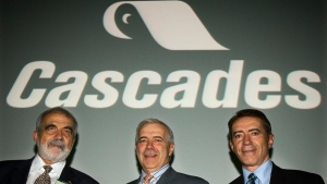 FILE -- Cascades paper company President and CEO Alain Lemaire, centre, is flanked by his brothers Bernard, left, chairman of the board and Laurent, vice-president, as they pose for a photograph prior to the company's annual meeting Thursday, May 4, 2006 in Montreal. (CP PHOTO/Paul Chiasson)