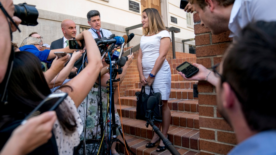 Foreign Affairs Minister Chrystia Freeland speaks to members of the media as she arrives at the Office Of The United States Trade Representative, Tuesday, Aug. 28, 2018, in Washington.  (AP Photo/Andrew Harnik)