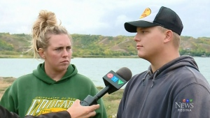 Ryan Geldenhuys (right) and his sister Corrinna Howard talk about the search for their missing brother near Saskatchewan's Echo Lake on Aug. 28, 2018. (CTV Regina)