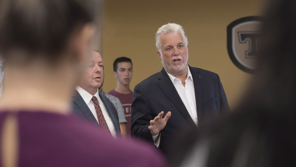 Quebec Liberal Leader Philippe Couillard speaks to students while visiting a college in St-Agapit Que., on August 28, 2018. (Jacques Boissinot   THE CANADIAN PRESS)