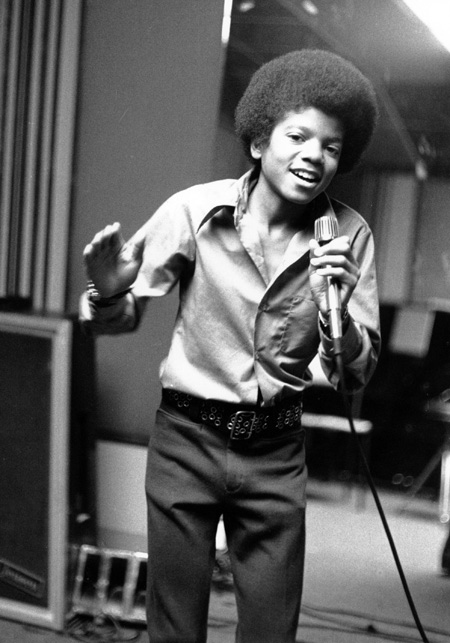 Michael Jackson at age 13, the youngest member of the Jackson Five, sings in his home in Encino, Ca in 1972. (AP Photo, file)