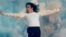 In this Jan. 31, 1993, file photo, Michael Jackson performs during the halftime show at the Super Bowl XXVII in Pasadena, Calif. (AP / Rusty Kennedy, File)